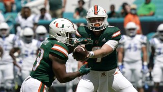 Miami Hurricanes QB Tyler Van Dyke hands off to running back Cam'Ron Harris, Sept. 25, 2021