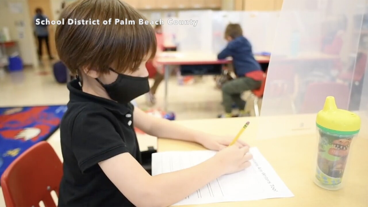 A Palm Beach County kindergarten student learns in-person during the 2020-21 school year.jpg