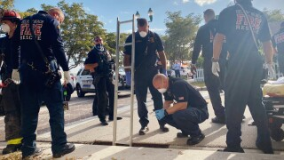 Rescuers look down at woman in storm drain in Delray Beach