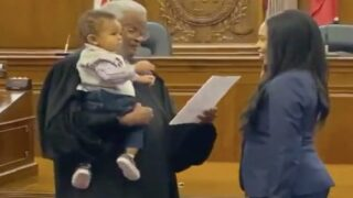 Watch This Awesome Judge Swear In A New Lawyer While Bouncing Her Baby On His Hip