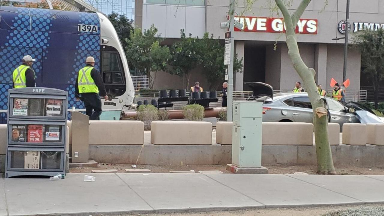 Phoenix police have identified a wrong-way driver who died after her car collided with a light rail train.