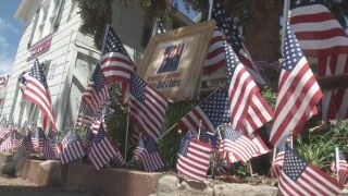 Hundreds of flags decorate coffee shop belonging to fallen soldier and wife