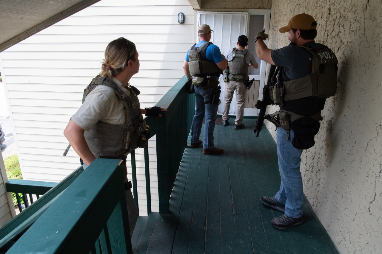 U.S. marshals prepare to enter home as part of 'Operation Not Forgotten'