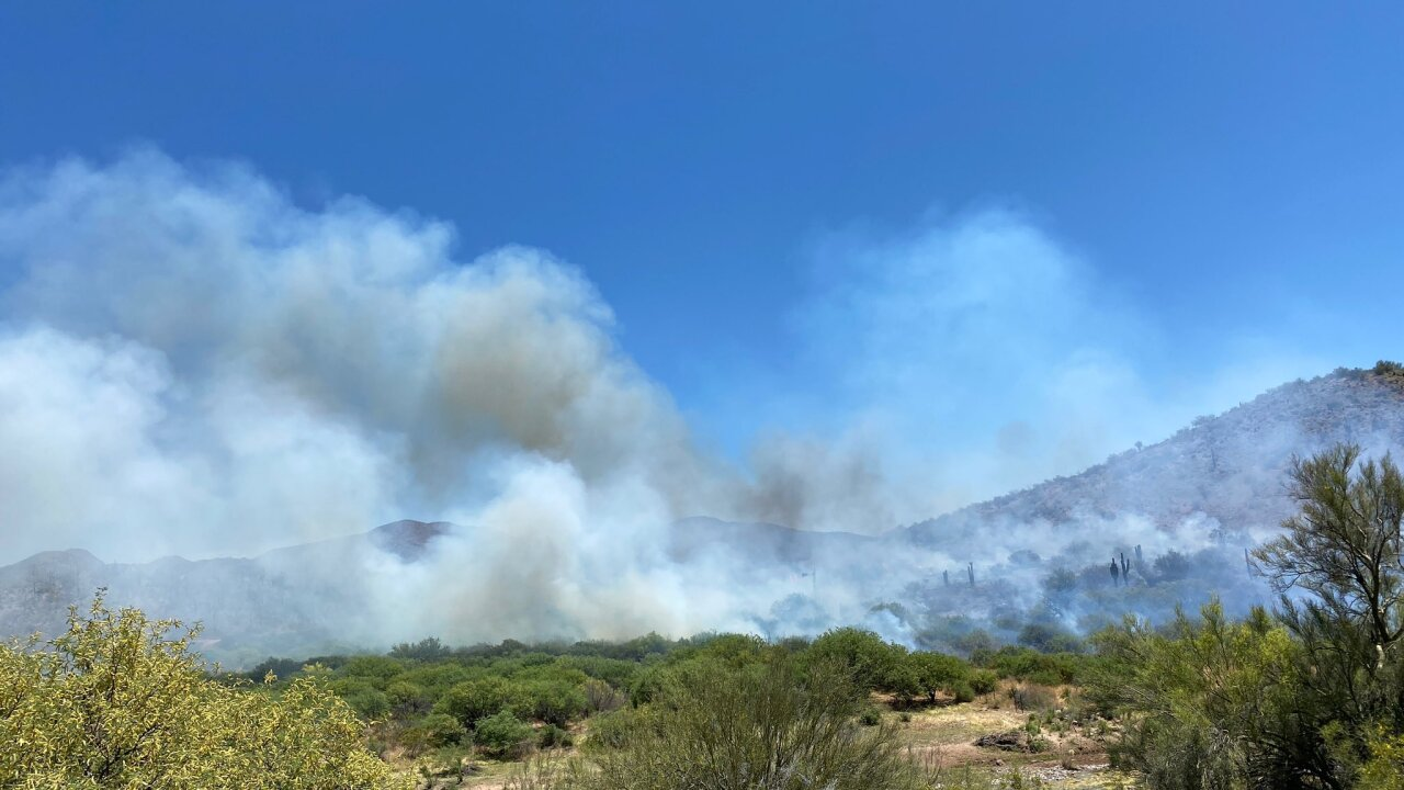 Firefighters battling large brushfire near Interstate 17 and New River Road
