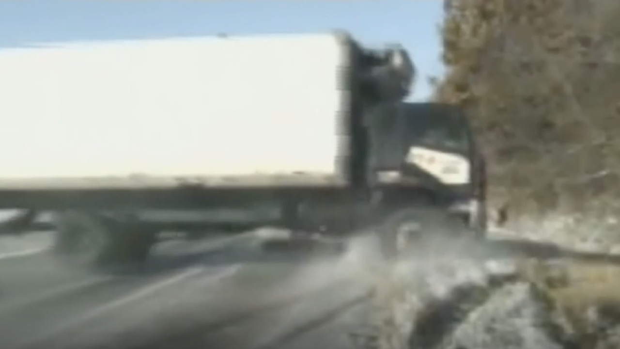 Out-of-control truck narrowly avoids stranded motorist, police officers in close call
