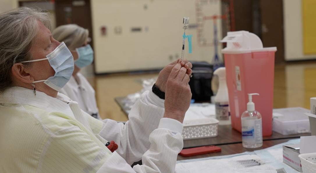 Sparrow nurse draws Pfizer vaccine for Waverly student clinic