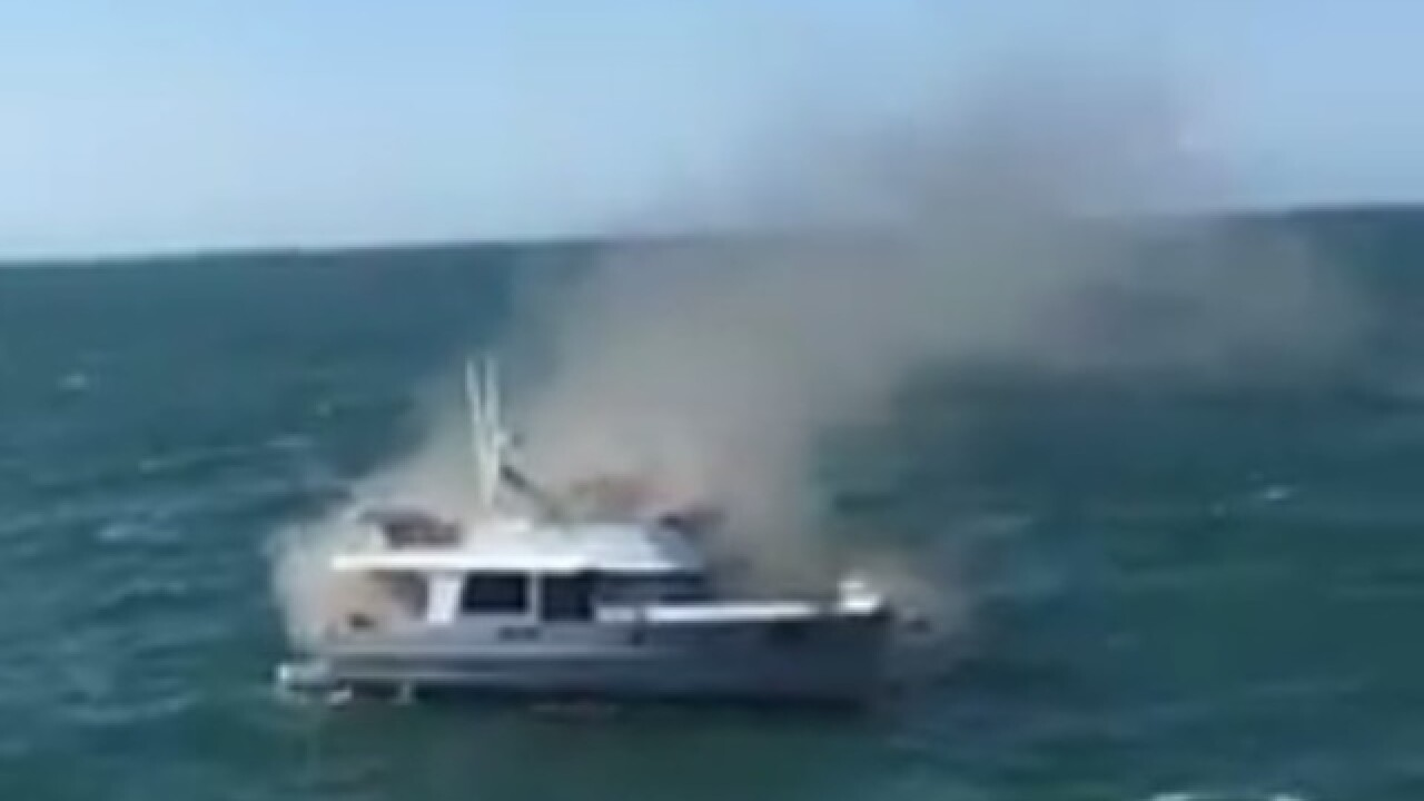 Family rescued from boat fire by passenger ferry
