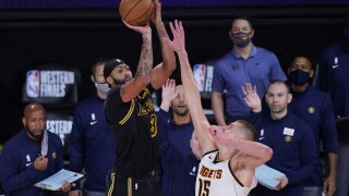 Davis hits 3 at buzzer, Lakers edge Nuggets for 2-0 lead