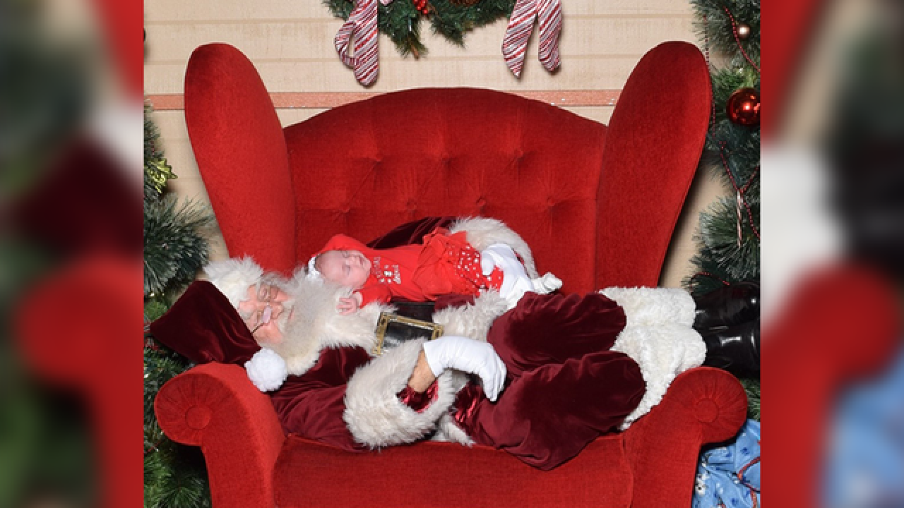 Santa takes a nap with sleeping baby in adorable Christmas photo
