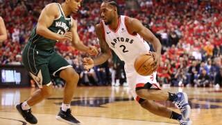 Kawhi Leonard #2 of the Toronto Raptors drives to the basket against Malcolm Brogdon #13