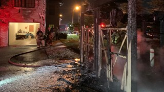 Fond du Lac dumpster structure fire wreckage