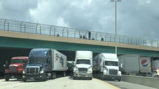Truckers lined up under a Florida highway to save a man who threatened to jump