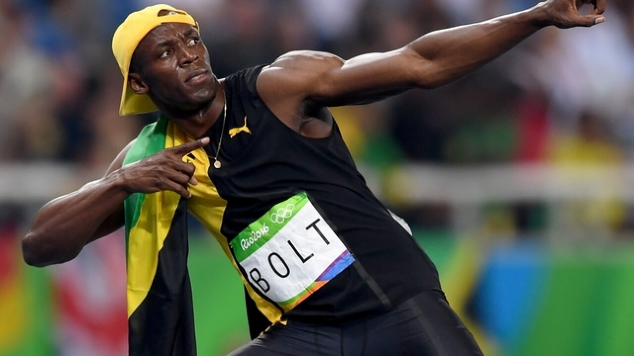 Usain Bolt takes Olympic 200, but still comes short of record