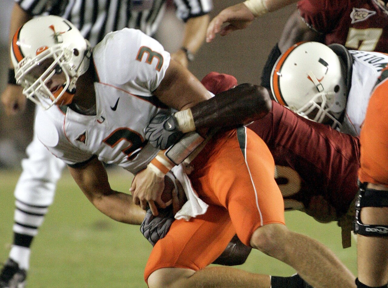 Miami Hurricanes QB Kyle Wright sacked by Florida State Seminoles defensive tackle Andre Fluellen in 2005