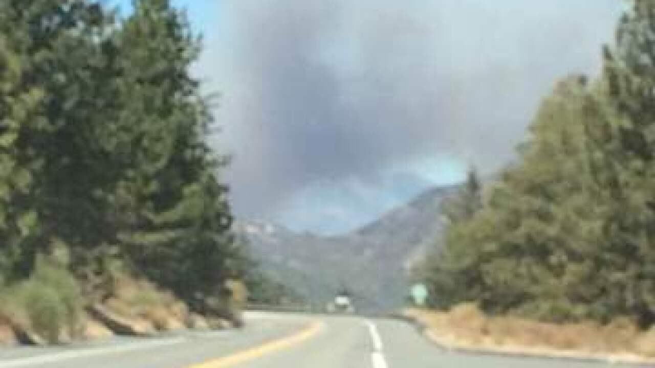Fire burns in California near highway to Vegas