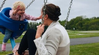 Kendra Bylsma and a daughter on swings