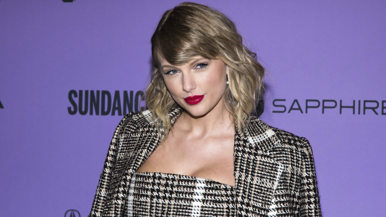 Taylor Swift says she will release surprise album at midnight