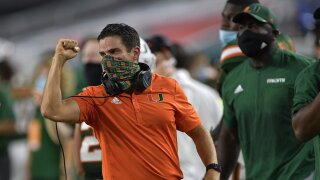 Miami Hurricanes head coach Manny Diaz celebrates TD vs. Florida State Seminoles in 2020