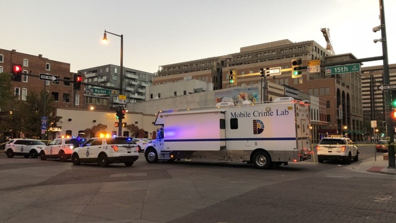 Man taken into custody after triple shooting in downtown Denver