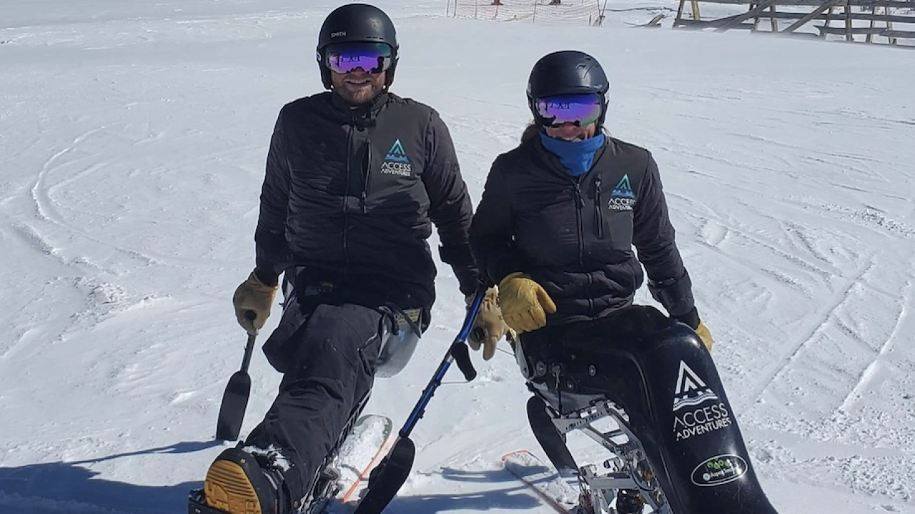 Jane Sowerby and Mark Urich skiing