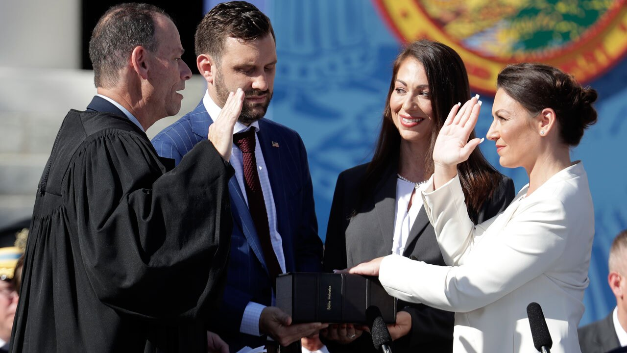 Nikki Fried, right, is sworn in as Florida Commissioner of Agriculture