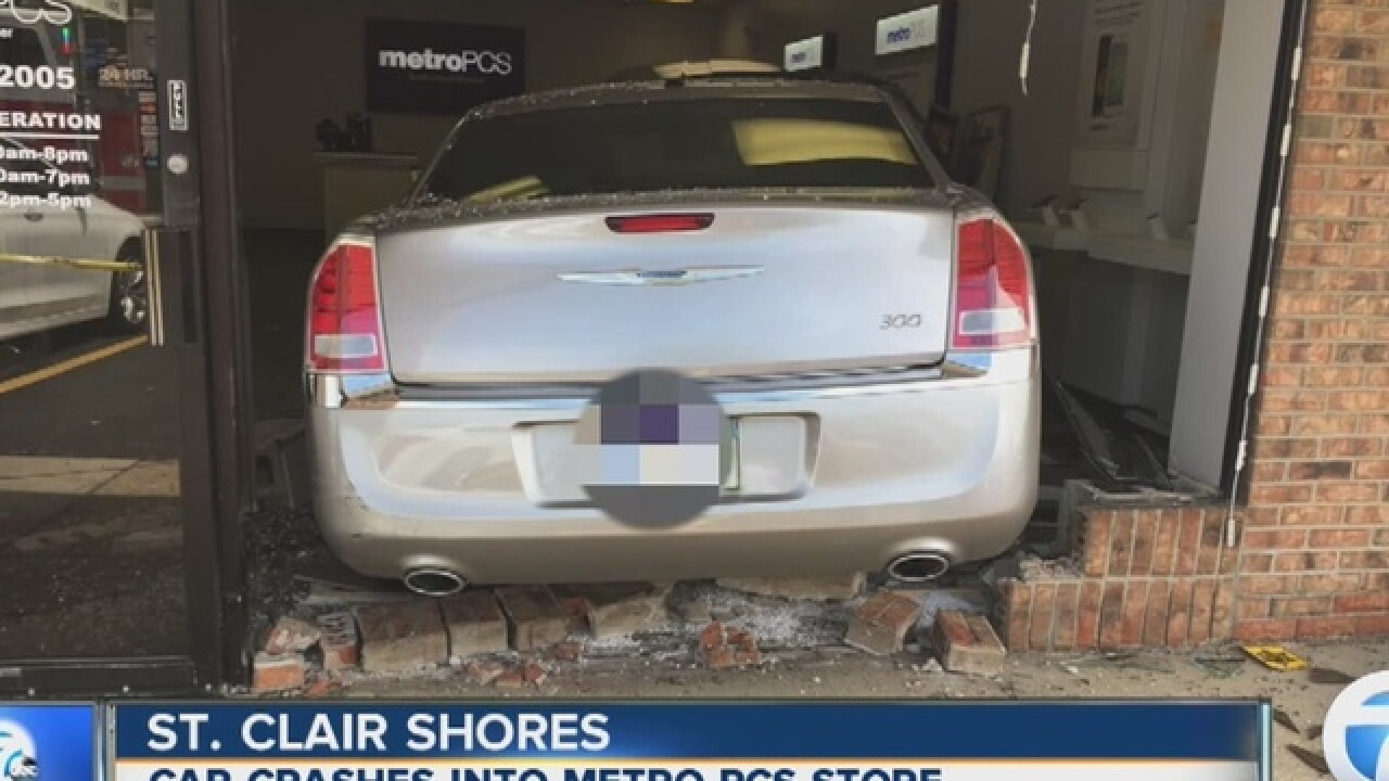 Vehicle smashes into Metro PCS store