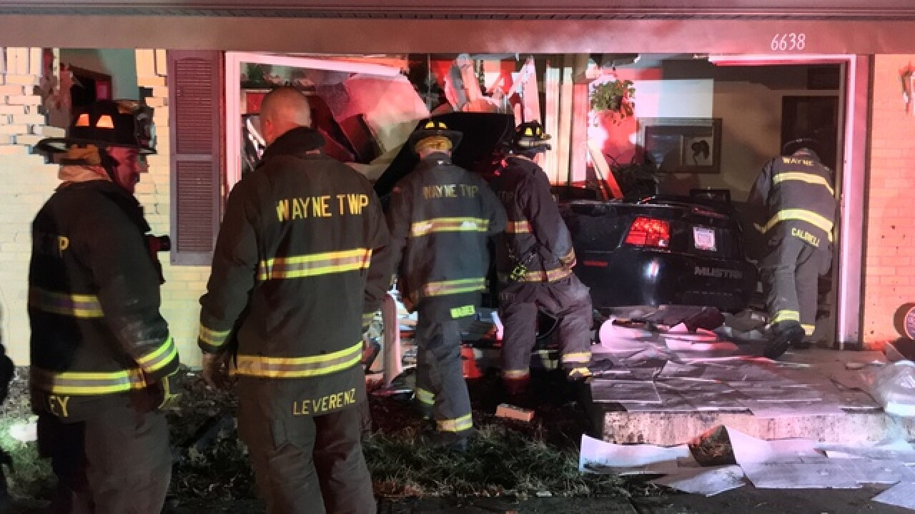 2 hurt when car crashed into home in Wayne Twp.