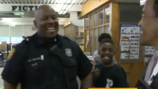 Norfolk police officer takes action by pulling double duty!