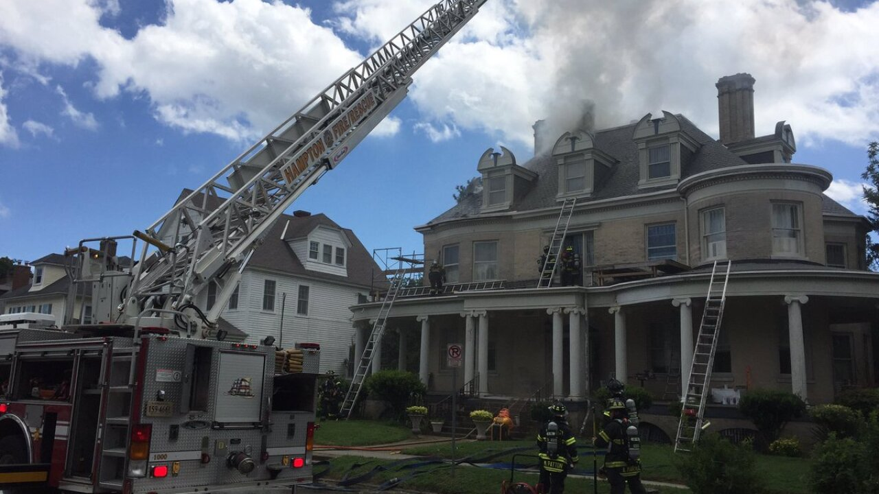 Firefighters put out three-story house fire in Hampton