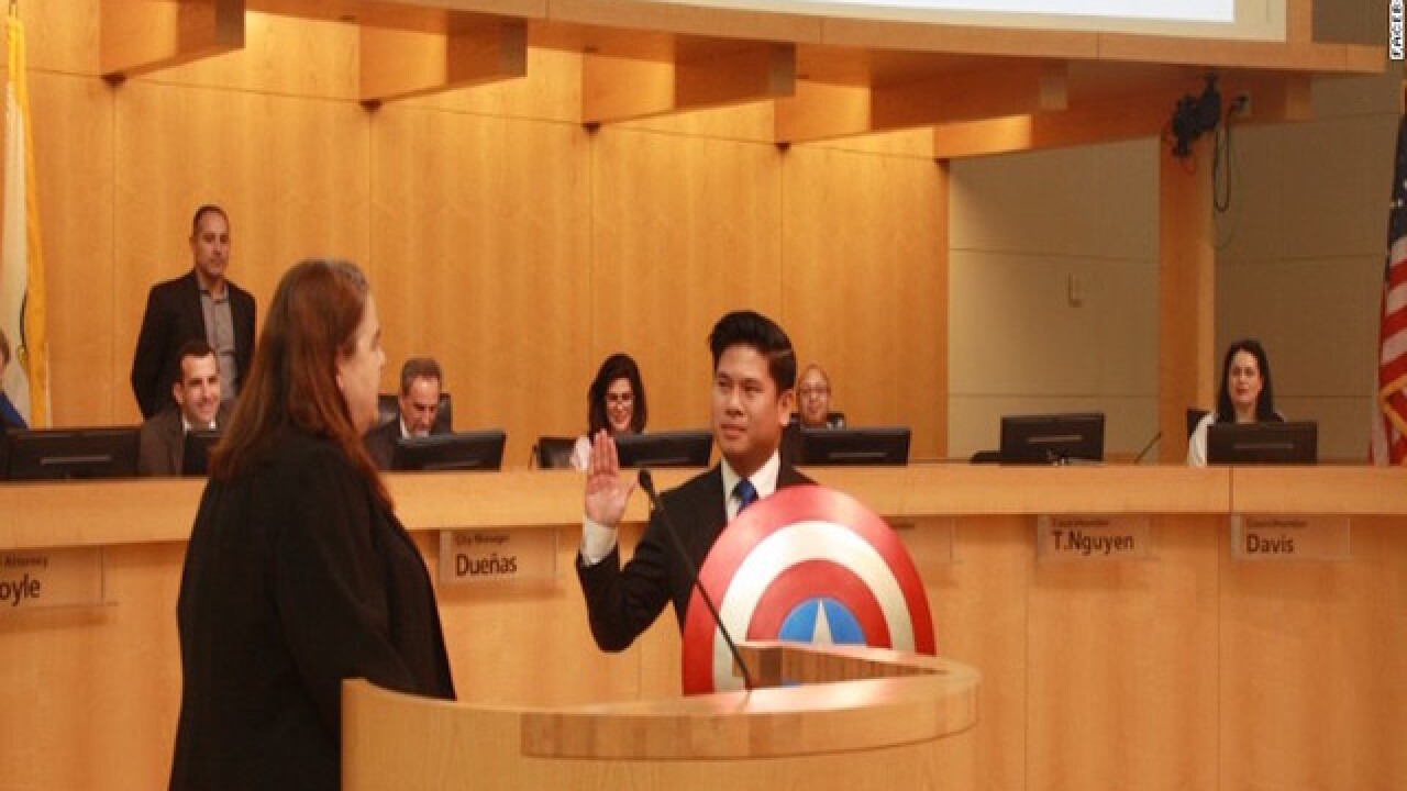 City councilman carries Captain America sheild during swearing-in ceremony