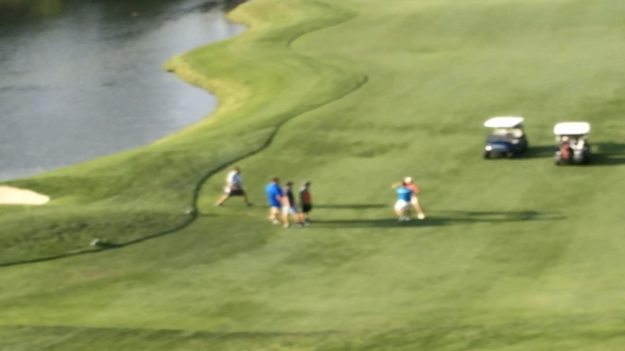 VIDEO: Golden golf course fight caught on camera
