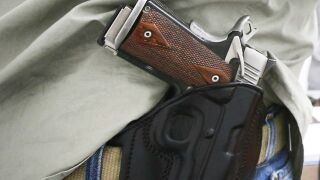 Monroe council opts to not allow guns in city meetings