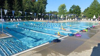 High school swimmers train in outdoor pools, hope for fall season