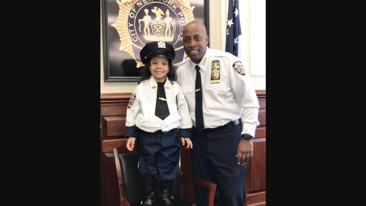 A young girl rescued from under a subway car is an honorary NYPD officer