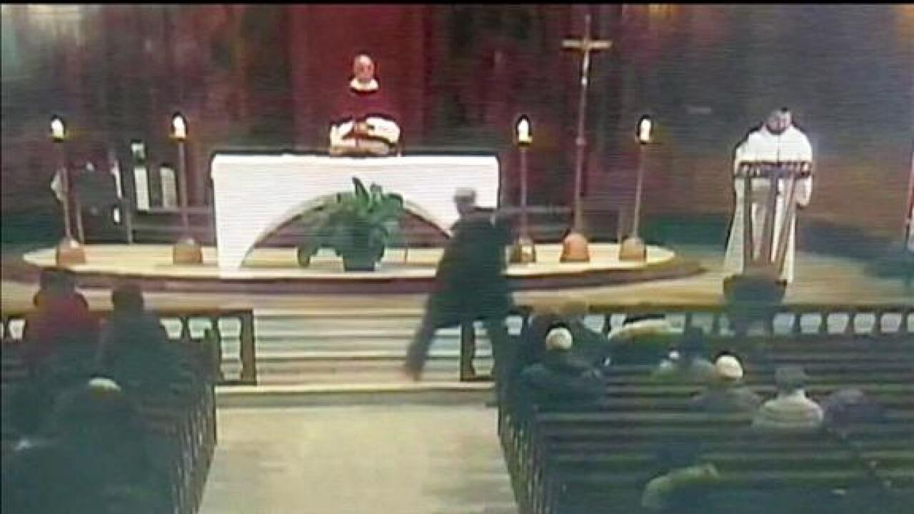 Suspect to appear in court after allegedly stabbing a priest during televised Mass