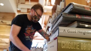 Staff sort books at Lewis and Clark Library