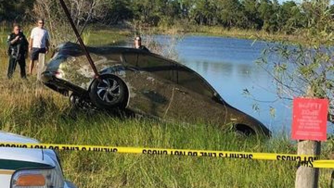 Deputies respond to vehicle submerged in pond