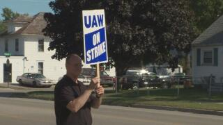 Sexton teacher Victor Celentino joins the picketing UAW workers at local 602.