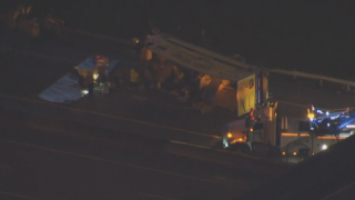overturned tractor-trailer in northbound lanes of Florida's Turnpike in Palm Beach Gardens