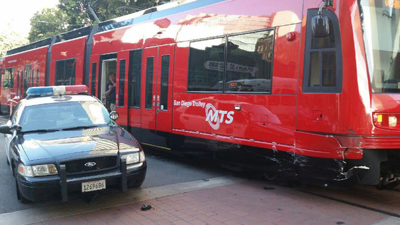 SDPD cruiser collides with trolley downtown
