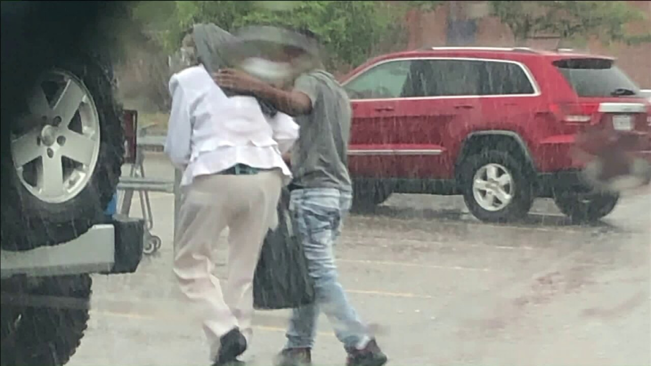 Missouri police look for teen who shielded elderly woman from rain with his jacket