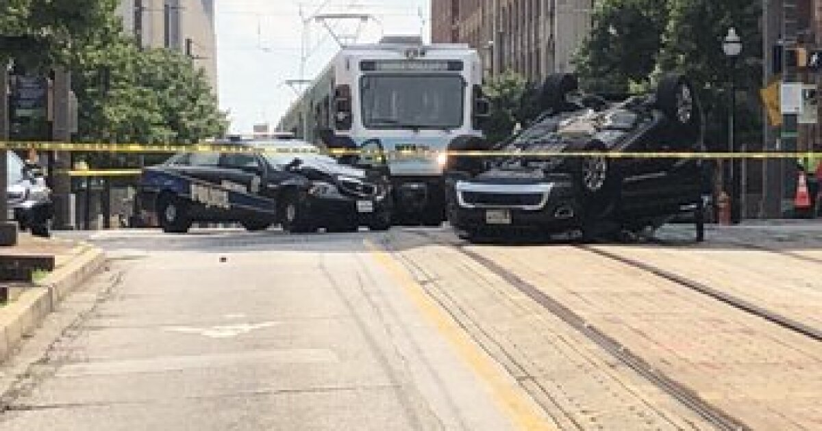Officer responding to bank robbery near UMB gets into car crash