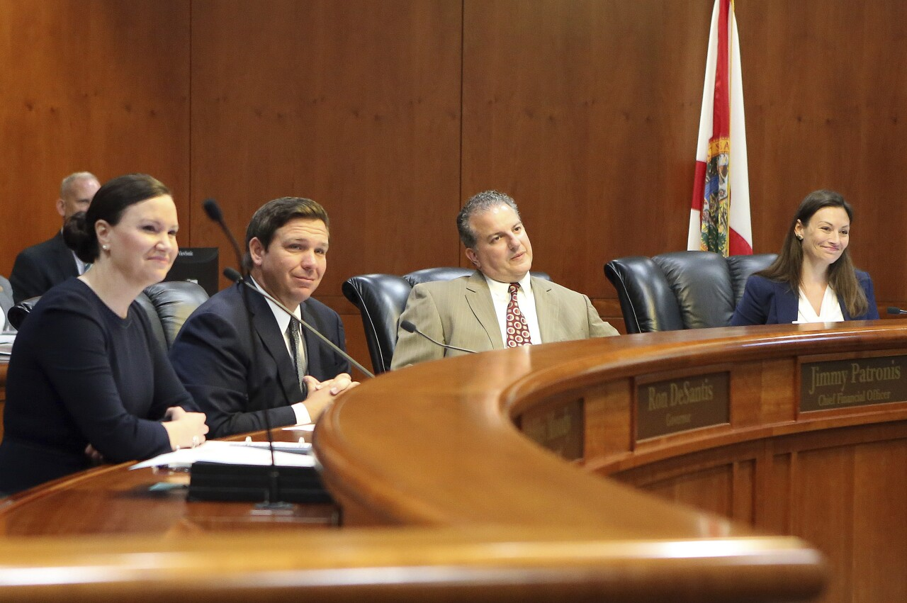 Florida Cabinet members Ashley Moody, Ron DeSantis, Jimmy Patronis and Nikk Fried in July 2019