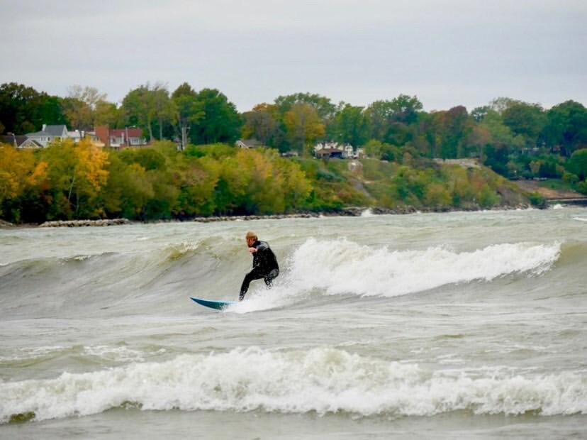 Chris Kish, Elyria native, catches a wave at Edgewater Beach.