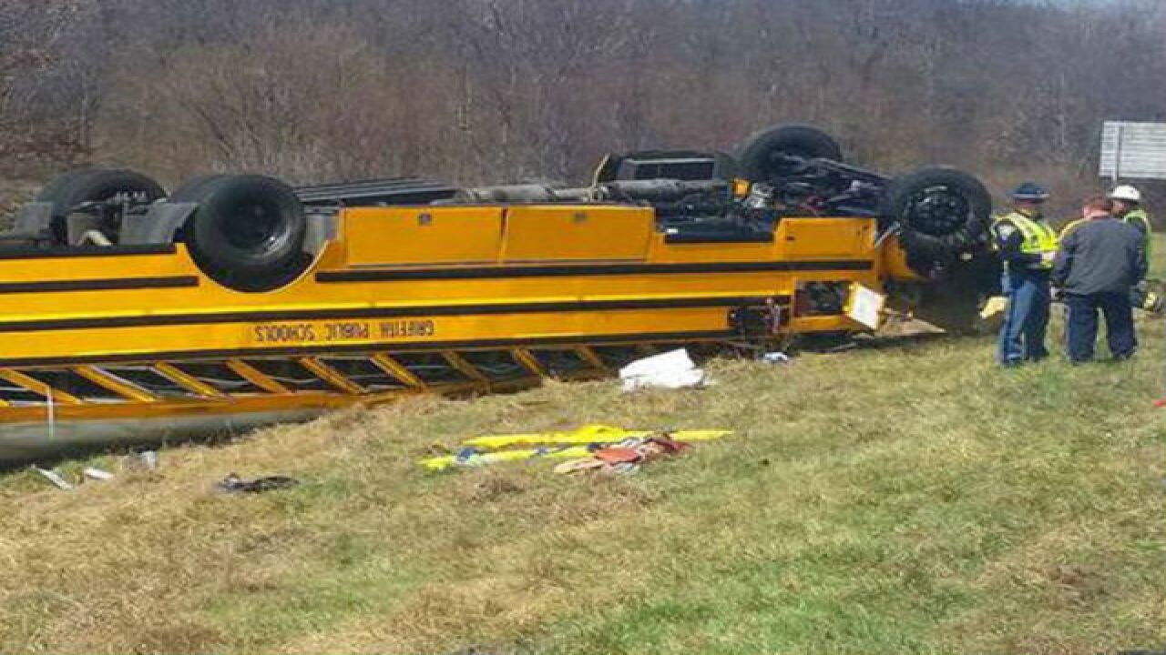 Bus carrying basketball team flips on I-65