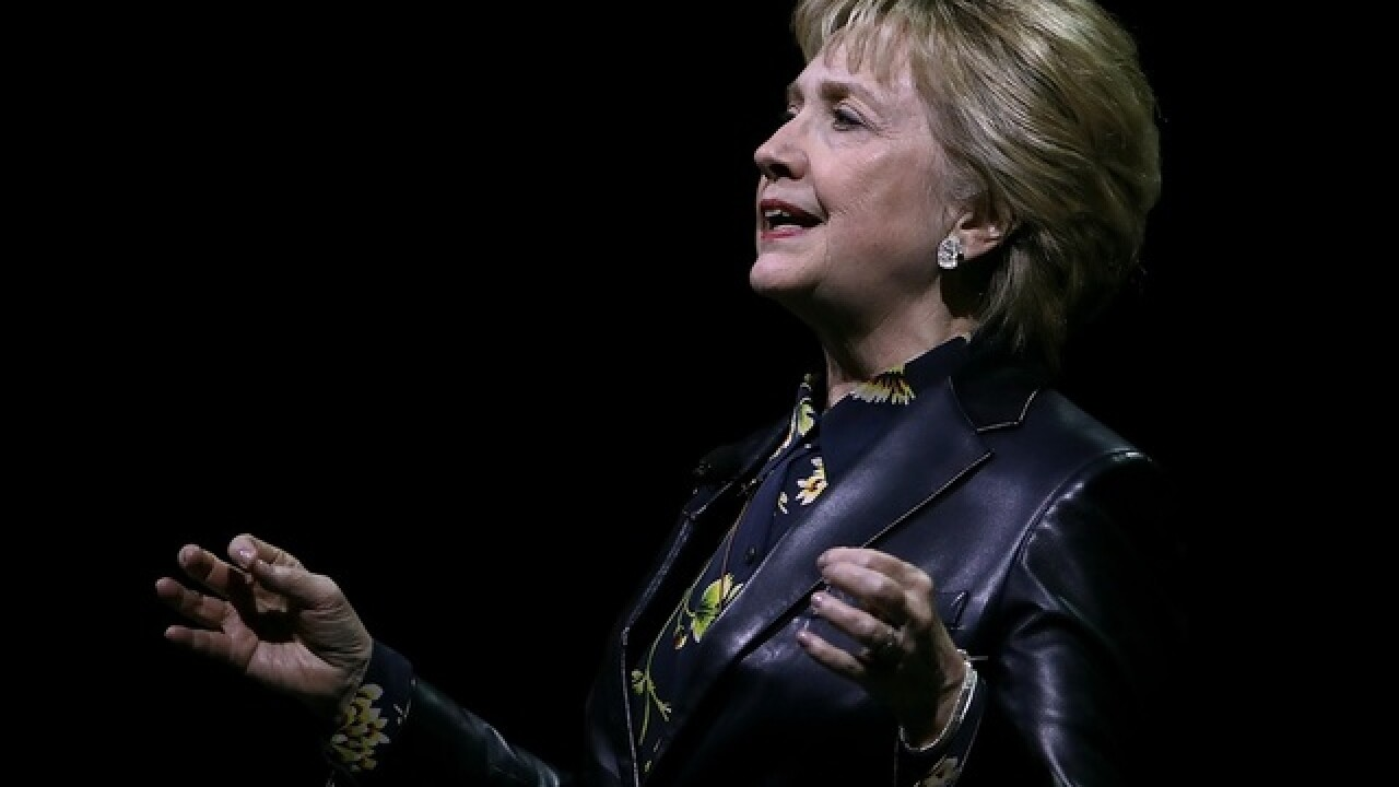 Clinton jabs Trump in first post-election speech
