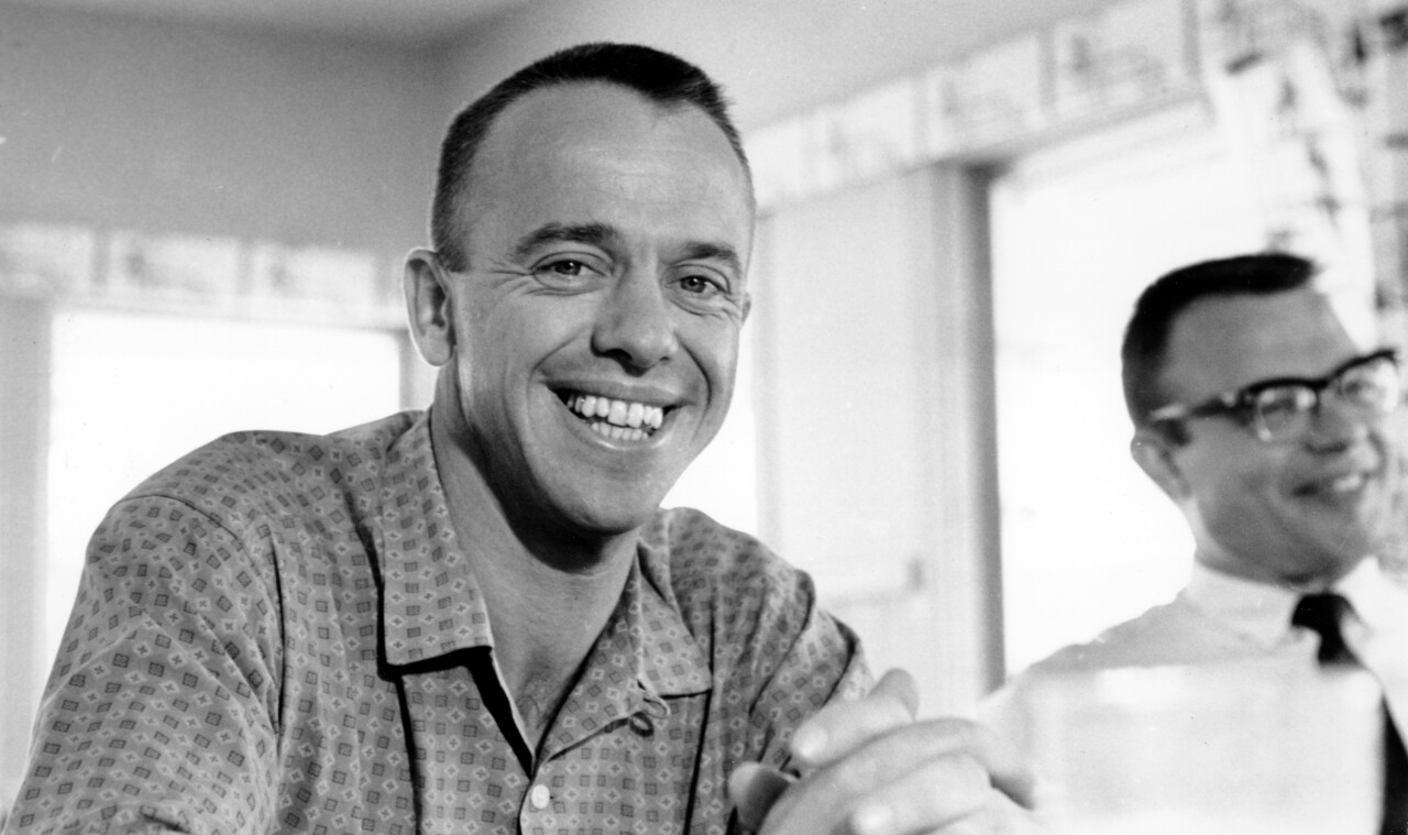 Astronaut Alan B. Shepard Jr., first American to be launched into space, flashes a smile at breakfast in Grand Bahama Islands on May 7, 1961. Shepard successfully completed his 15-minute suborbital flight 115 miles high in his capsule, Freedom 7, landing 302 miles downrange from his Cape Canaveral, Fla. launch site. (AP Photo)