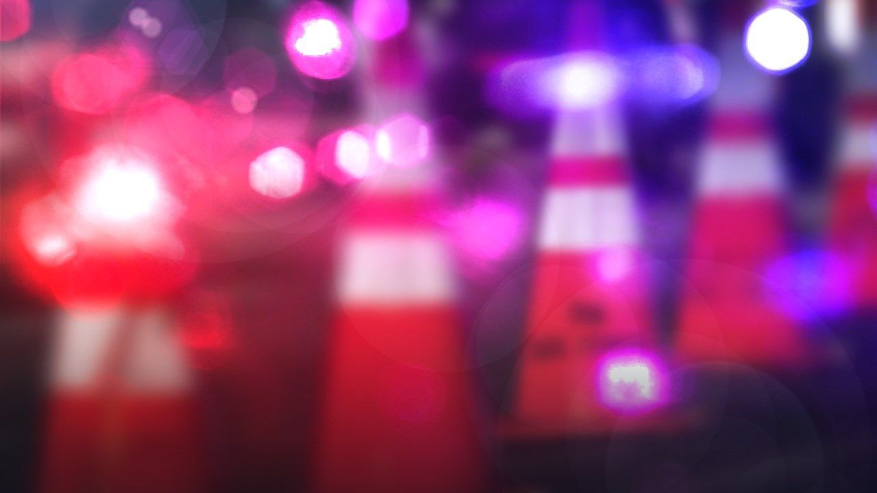 Road closed after car hits utility pole