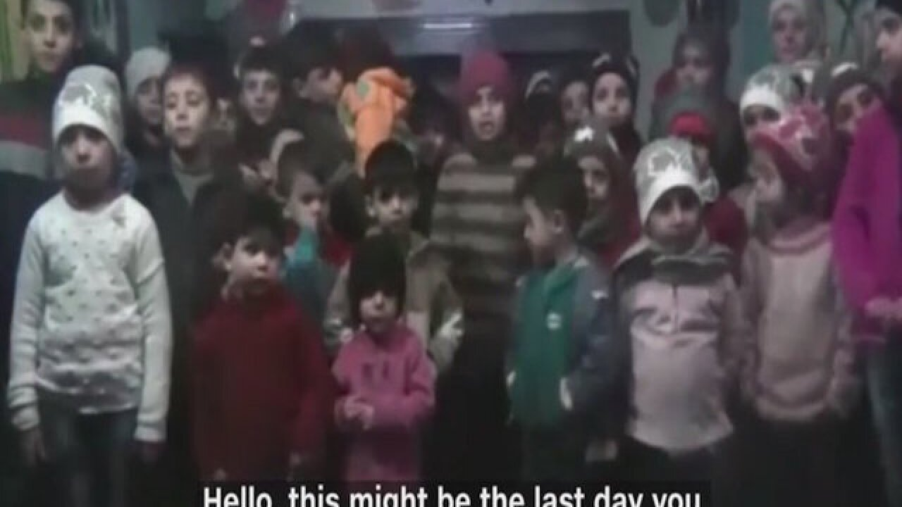Aleppo children evacuated after being trapped in orphanage