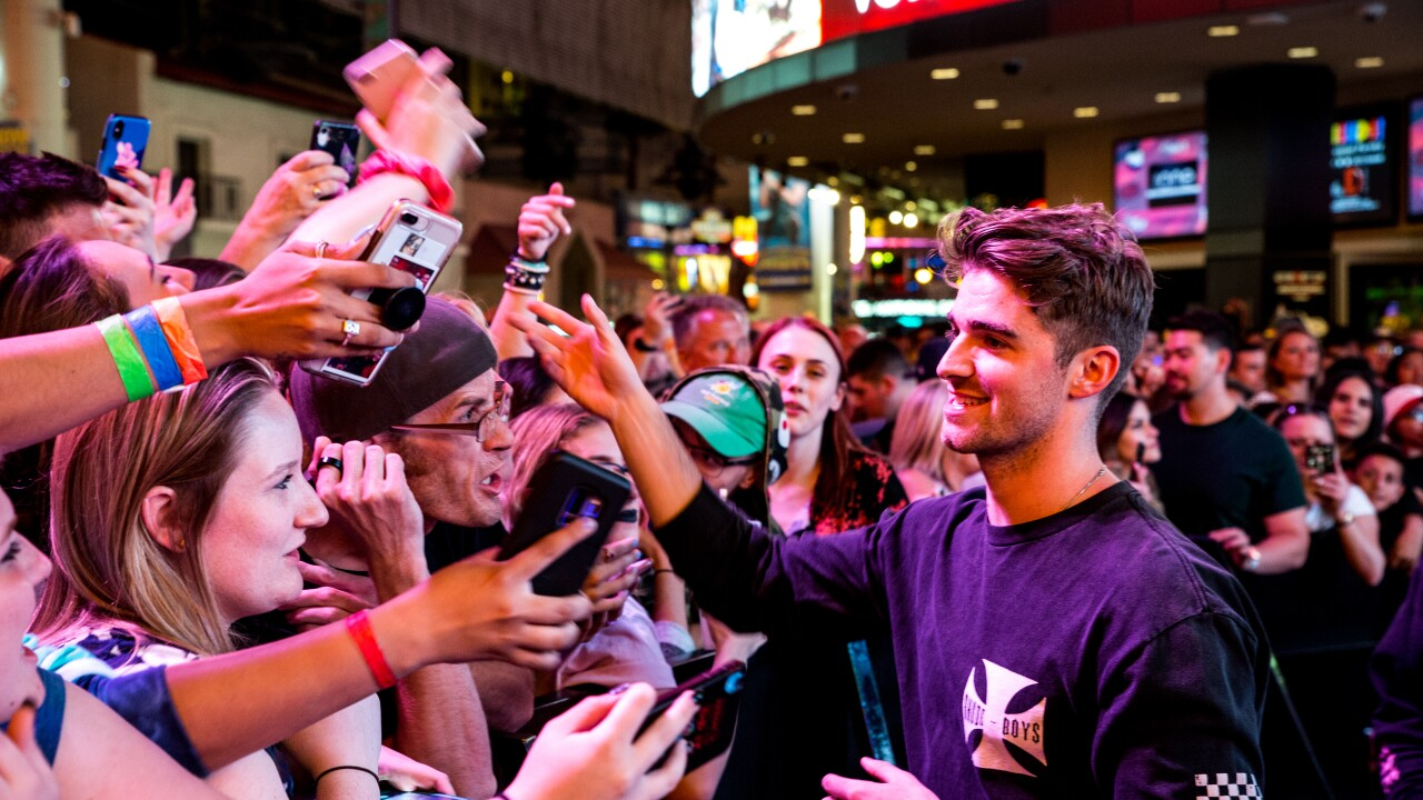 Fans celebrate with Drew Taggart of The Chainsmokers during Viva Vision light show debut at Fremont Street Experience, 5.31.19.jpg